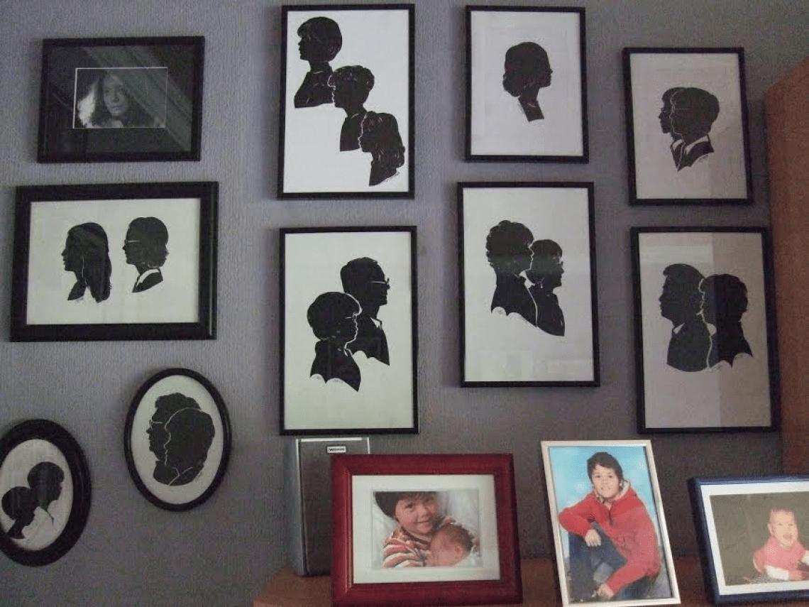 Wohnen mit Scherenschnitt-Porträts von den Lieben. Eine heimische Scherenschnitt-Galerie im Wohnzimmer.