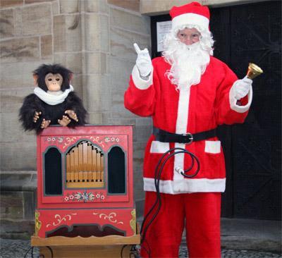 Weihnachtsmann Weihnachtsmann mit Drehorgel